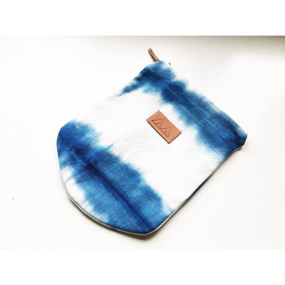 Front view of the Shibori pouch featuring hand dyed vintage linen fabric.
