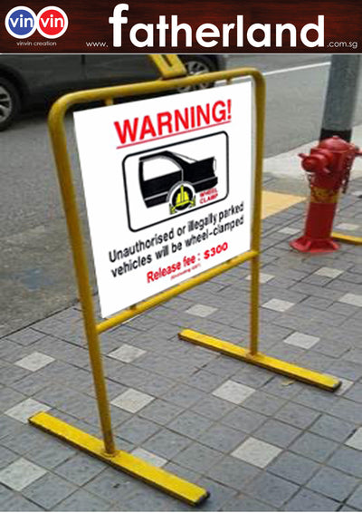 WARNING UNAUTHORISED OR ILLEGALLY PARKED VEHICLE WILL BE WHEEL CLAMPED WITH STANDS