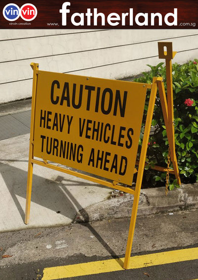 CAUTION HEAVY VEHICLE TURNING AHEAD OUTDOOR SIGN