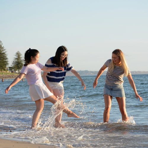Students in water at Glenelg beach