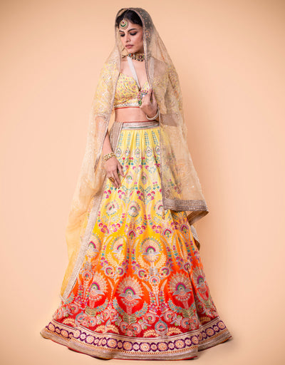 Ombre Kalidar Lehenga Featuring Dabka Work And French-Knot Hand Embroidery. Paired With An Embroidered Blouse And Printed Dupatta In Sheer Silk.