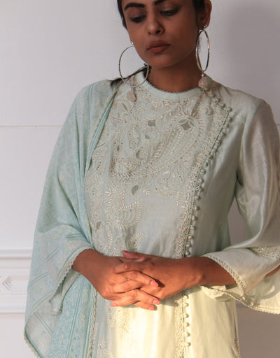Angarakha-Style Kurta In Chanderi Featuring Chikankari Embroidery. Paired With Trousers In Chanderi And A Printed Stole With Fringe And Lace Detailing.
