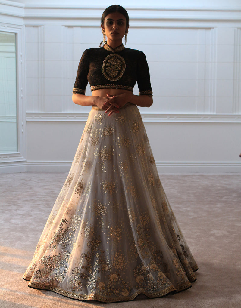 Lehenga In Tulle Featuring Floral Hand Embroidery, Highlighted With Mukaish Detailing. Paired With A Lace Blouse