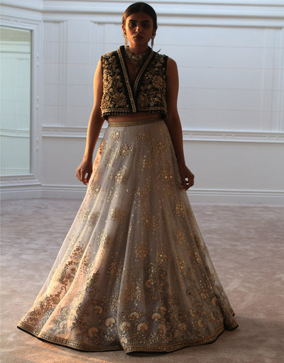 Lehenga In Tulle Featuring Floral Hand Embroidery, Highlighted With Mukaish Detailing. Paired With A Lace Blouse/ Embroidered Gilet