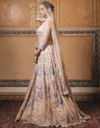 Kalidar Lehenga In Tulle Featuring Multi-Coloured Floral Sheer Silk Applique Work, Highlighted With Sequins. Paired With A Resham Embroidered V-Neck Blouse And A Tulle Dupatta.
