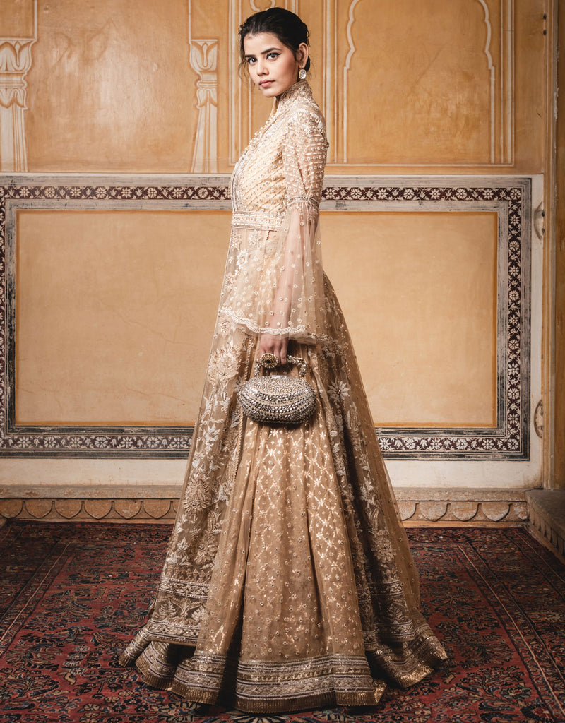 Long Jacket Featuring Side Slits In Tulle With Velvet Appliqué Detailing And Pearl Embroidery, Paired With A Skirt In Chanderi Brocade.