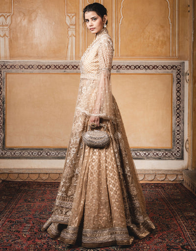 Long Jacket Featuring Side Slits In Tulle With Velvet Appliqué Detailing And Pearl Embroidery. Paired With A Skirt In Chanderi Brocade.