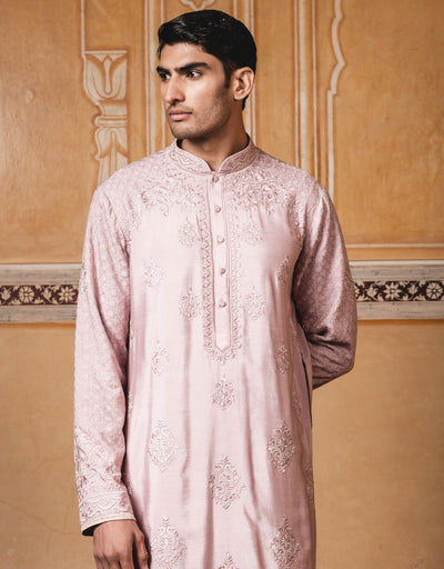 Salmon color mulmul kurta ,with all over resham thread work.Paired with maching churudar.