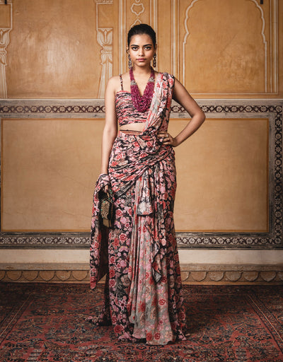 Digitally Printed Saree In Georgette With Fringe And Lace Detailing. Paired With A Digitally Printed Chiffon Blouse With Diamonds On The Straps.