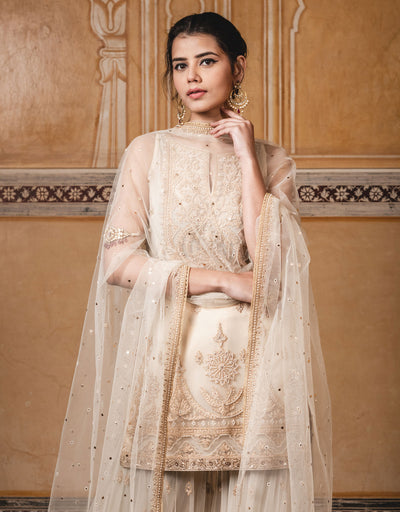 Short Kurti In Tulle Featuring Dori Embroidery. Paired With Sharara Pants And A Tulle Dupatta With Mukaish Detailing.