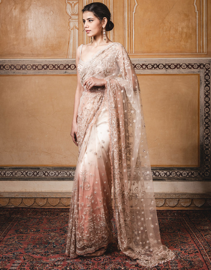 Saree In Tulle Featuring Delicate Resham Aari Embroidery Highlighted With Sequins And Diamonds.