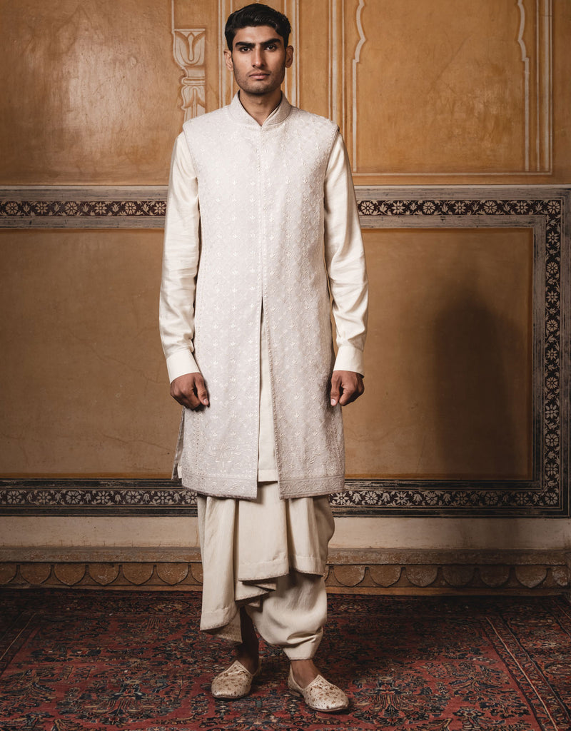 Oyester color sleeveless  sherwani,handcrafted in pure georgette fabric with all over intricate lucknowi chikan work in ivory, Paired with kurta and dhoti.
