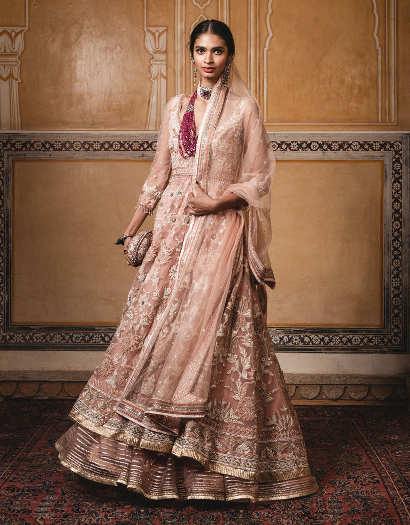 Anarkali With A Trail In Tulle Featuring Velvet Appliqué Work And Pearl Embroidery. Paired With A Tulle Dupatta And Churidar.