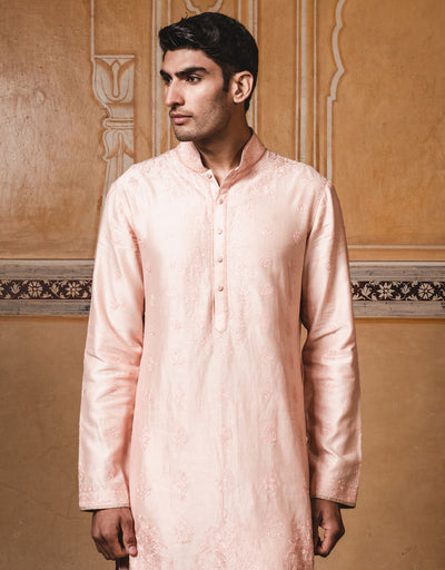 Peach kurta in chanderi fabric,with all over aari embroidery.Paired with matching churidar.