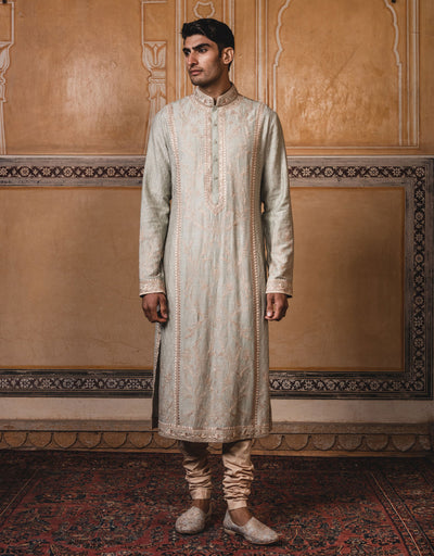 Jade color kurta in mooga silk fabric ,with all over aari, resham and badla work.Paired with maching churidar.