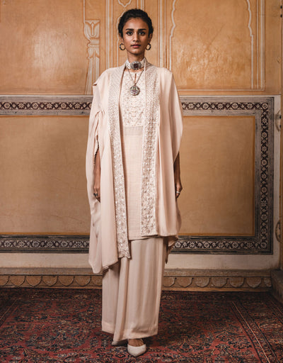 Cape In Georgette With Hand Embroidered Borders On The Neckline And Placket. Paired With An Embroidered Georgette Kurta And Trousers.