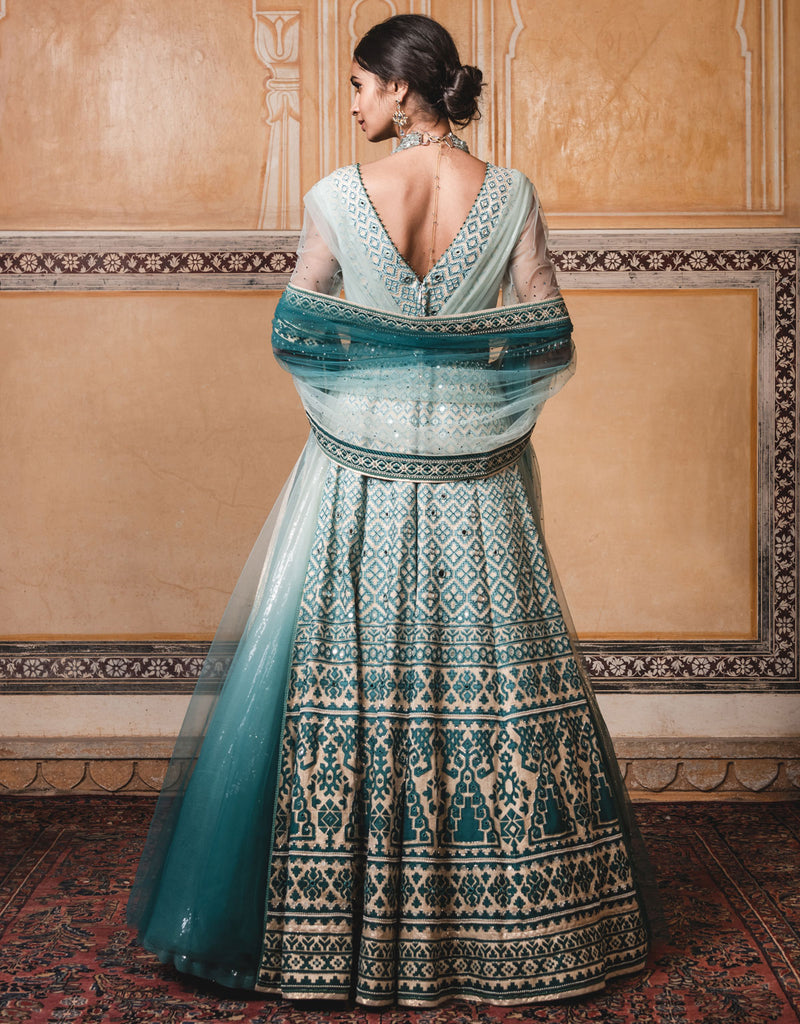Anarkali In Raw Silk With Shaded Appliqué Embroidery, Highlighted With Mirror Work.