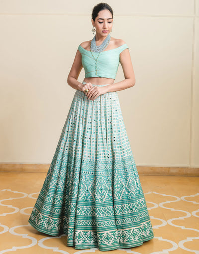 Lehenga In Raw Silk Featuring Mirror And Cut-Dana Embroidery. Paired With A Fluted Chiffon Blouse And An Ombre Tulle Dupatta