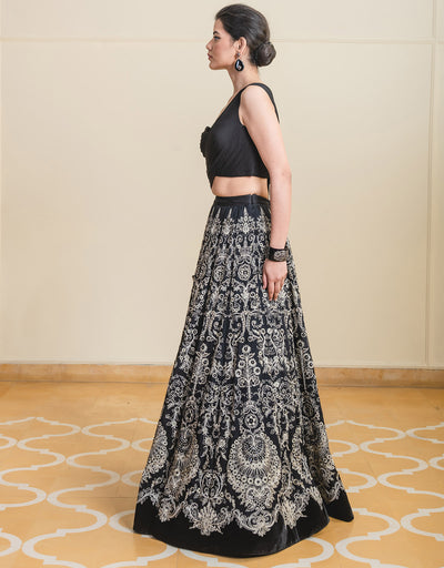 Lehenga In Sheer Silk Featuring Resham Aari Embroidery Paired With A Draped, One Shoulder Blouse.