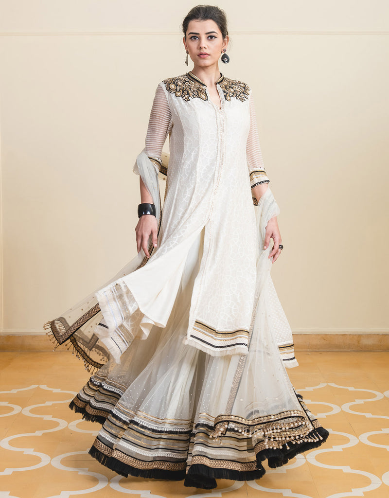 Front-Open Shirt-Style Kurta In Cutwork Fabric. Paired With Tulle Sharara Pants Featuring Multi-Lace Borders And A Tulle Dupatta Featuring Butti Work With An Embroidered Border.