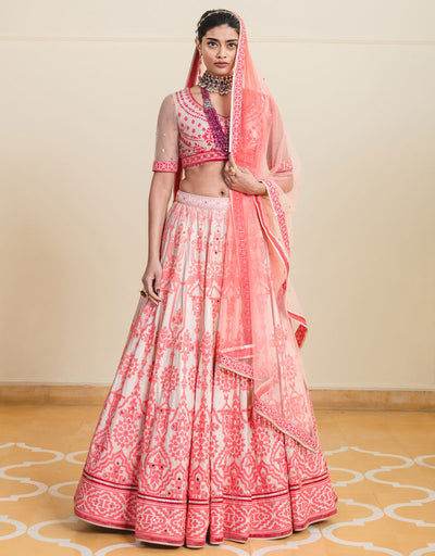 Lehenga In Raw Silk Featuring Mirror And Cut-Dana Embroidery. Paired With A Sleeveless Blouse Featuring Mirror Embroidery And Fringe Details.