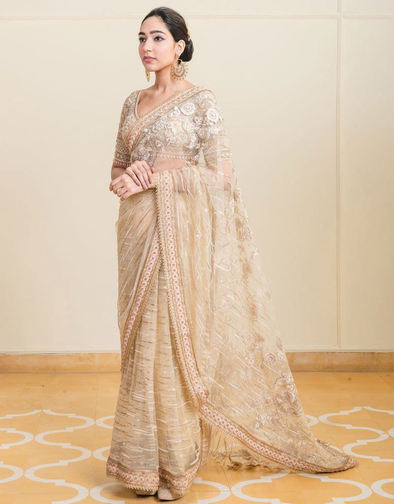 Saree In Tulle Featuring Resham And Sequin Embroidery. Paired With A Blouse Featuring French Knot Embroidery.