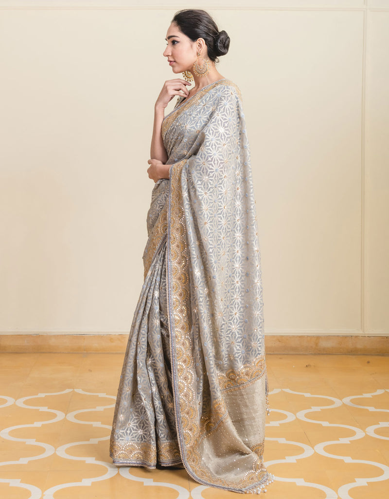 Saree In Chanderi Brocade Featuring Embroidered Borders With Gota Patti Work And Fringe Detailing. Paired With An Embroidered Blouse In Chanderi Brocade