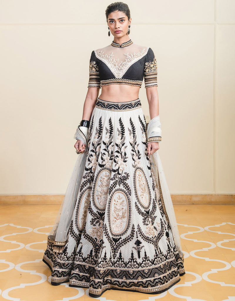 Lehenga In Tulle Featuring Contrasting Velvet Appliqué Work And Resham Embroidery, Layered With Cutwork Fabric & Paired With An Embroidered Mandarin Blouse.