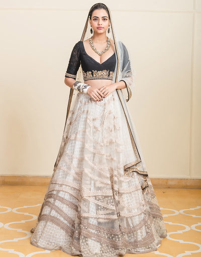 Lehenga In Tulle Featuring Dori Embroidery With Cutwork Fabric Paired With A Blouse With Hand-Embroidered Zardozi Detailing And A Tulle Dupatta.