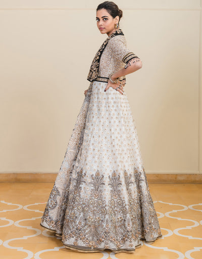 Anarkali In Tulle Featuring Resham And Badla Embroidery, Paired With An Embroidered Dupatta And Churidar.