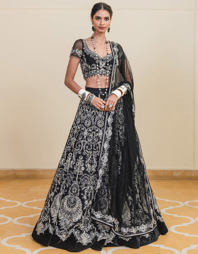 Lehenga In Sheer Silk Featuring Resham Aari Embroidery Paired With A Half-Sleeves Blouse In Tulle And A Dupatta In Sheer Silk.