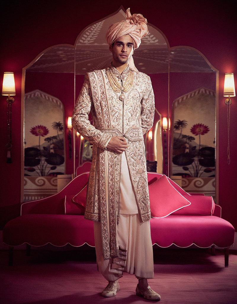 Sherwani In Matka Silk Featuring Intricate Zardozi And Resham Embroidery. Paired With A Silk Kurta, Dhoti, Embroidered Kamarbandh And Coordinated Stole.