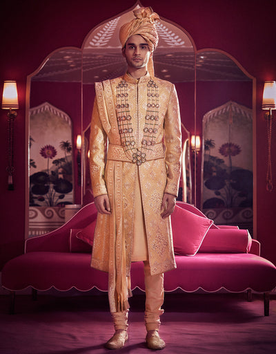 Sherwani In Raw Silk Featuring Aari And Zardozi Embroidery. Paired With A Kurta, Churidar, Kamarbandh, Stole, Safa And Juttis.