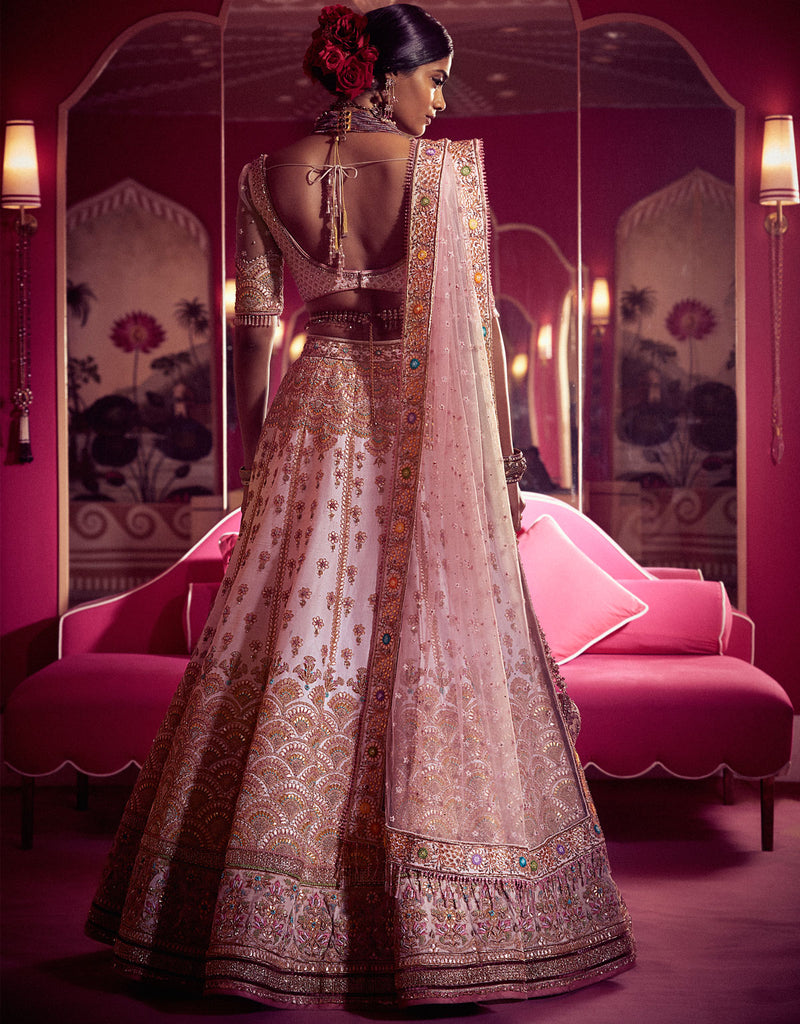 Bridal Lehenga And Blouse In Raw Silk Accentuated With Gota Embroidery, Paired With An Ombre Tulle Dupatta.