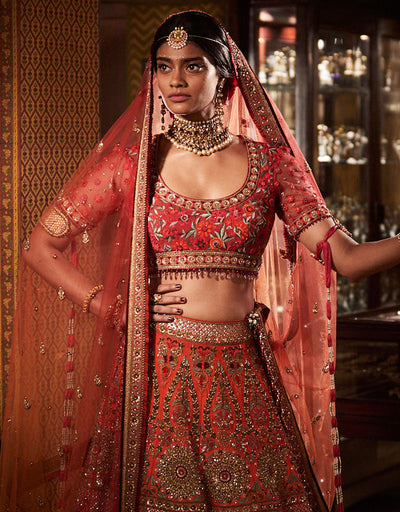 Bridal Lehenga In Raw Silk Accentuated With Zardozi, Resham And French Knot Embroidery In Vibrant Colours, Paired With A Resham Gara Embroidery Blouse And An Ombre Tulle Dupatta.