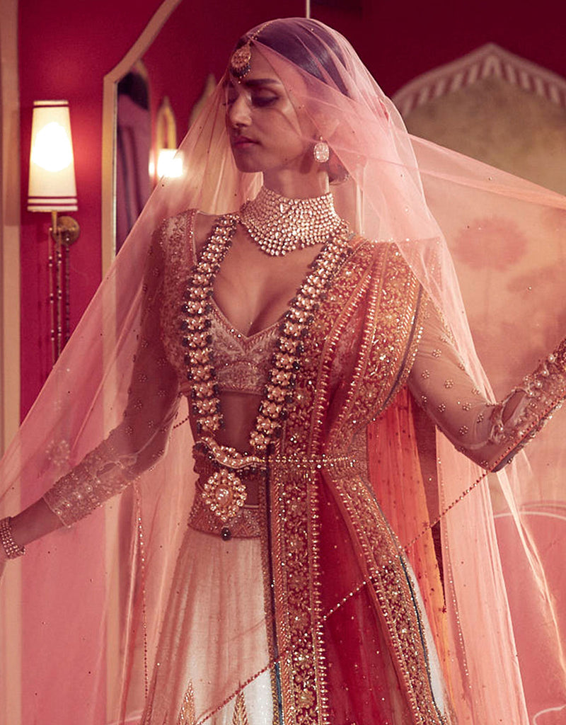 Bridal Lehenga In Matka Silk Featuring Gota Embroidery And Dori Work Highlighted With French Knots And Crystals. Paired With A V Neck Blouse In Matka Silk And An Ombre Tulle Dupatta.