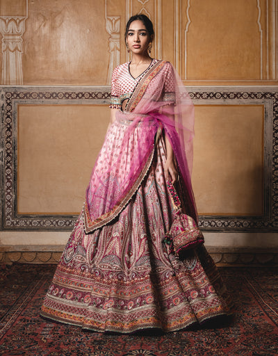 Ombre Kalidar Lehenga Featuring Kashida Embroidery, Highlighted With Pearl Detailing. Paired With A Blouse In Silk Dupion And An Ombre Dupatta In Tulle.