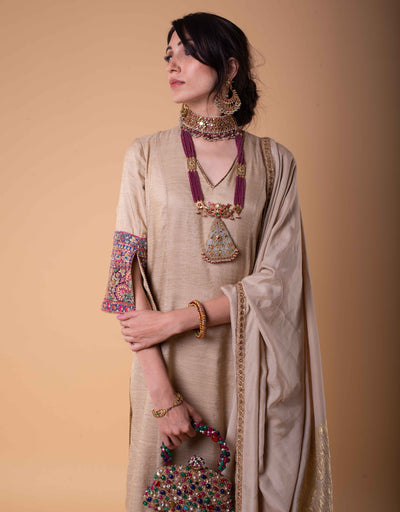 Straight Kurta In Tussar Silk Featuring Multi-Coloured Kashida Embroidery On The Cuffs And Hem. Paired With A Handloom Dupatta And A Churidar