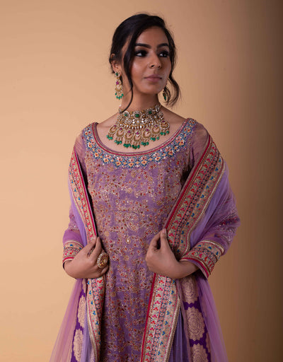 Kurti In Spun Silk With Tulle Sleeves Featuring Zari Embroidery And Sequin Detailing. Paired With Sharara Pants In Spun Silk And An Ombre Tulle Dupatta.