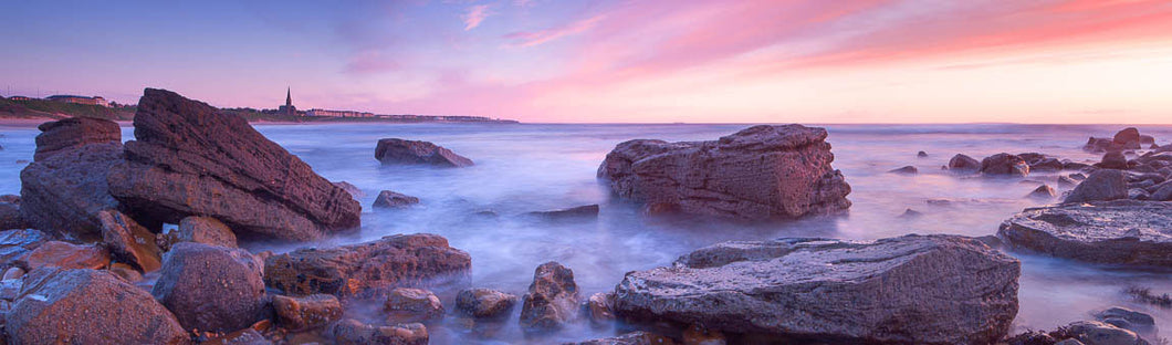 Tynemouth Longsands rocks at dawn panoramic photograph