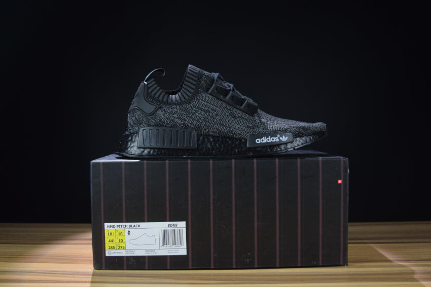 60587a47a2f NMD R1 Friends   Family Pitch Black