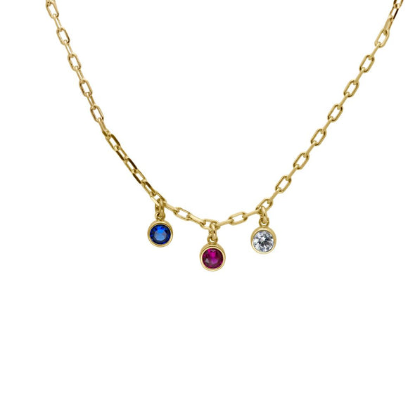 a gold vermeil necklace with three birthstones dangling from it