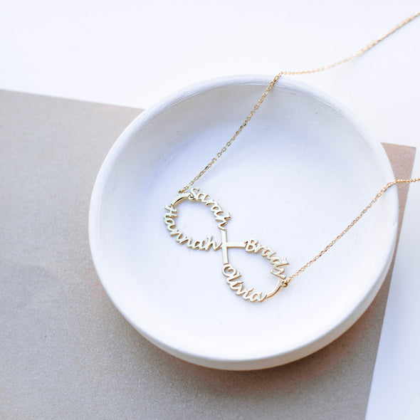 a sterling silver infinity necklace with names