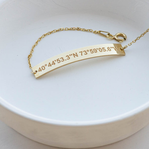 A gold plated personalized coordinates bracelet