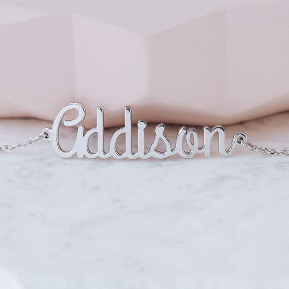 A sterling silver personalized name bracelet with the name Addison