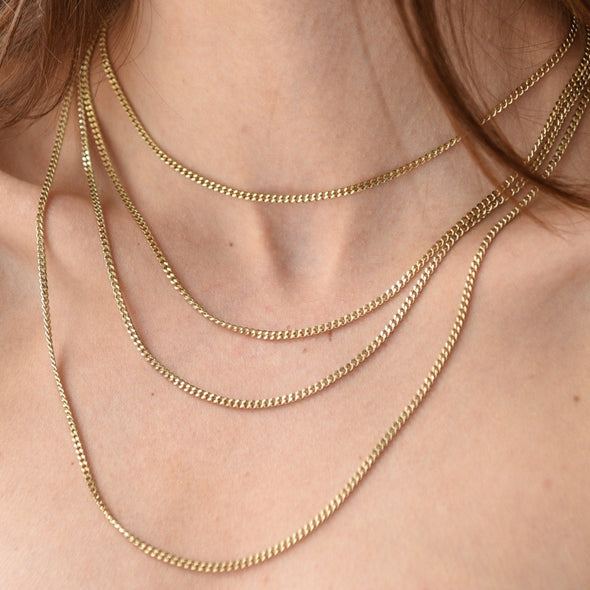 a layered gold chain necklace