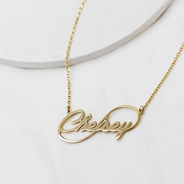 an ininity name necklace in gold color