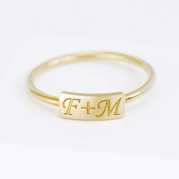 a gold custom name ring