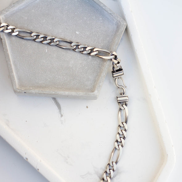 a silver figaro chain necklace 8mm