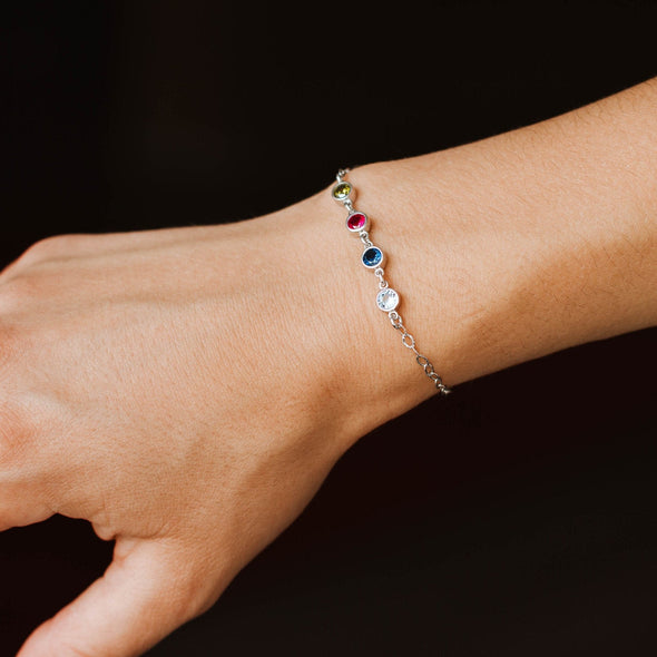a silver bracelet with birthstones